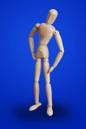 Sports fitness wooden toy figure on blue background