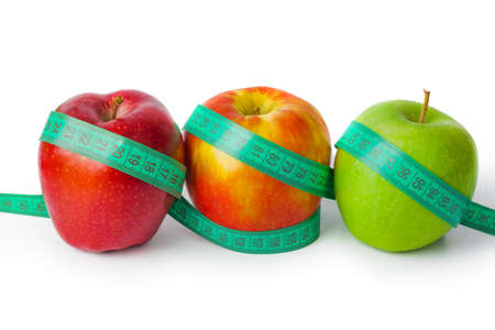 Apples and measuring tape isolated on white background Stock Photo