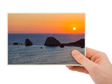 Hand and Aphrodite rock at sunset - Paphos Cyprus (my photo) isolated on white background