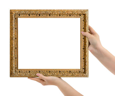 Wooden picture frame in hands isolated on white background