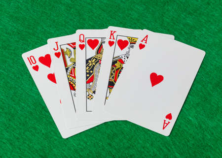 Casino playing cards on green table - gambling background