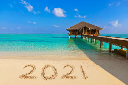 Numbers 2021 on beach - concept holiday background Stock Photo