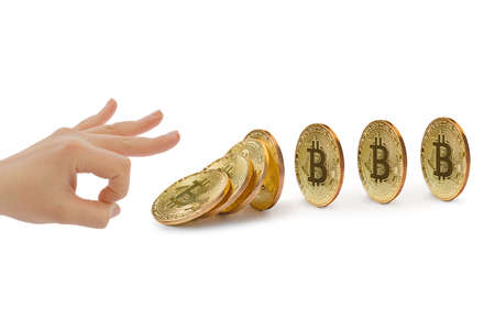Hand and falling bitcoins isolated on white background Фото со стока