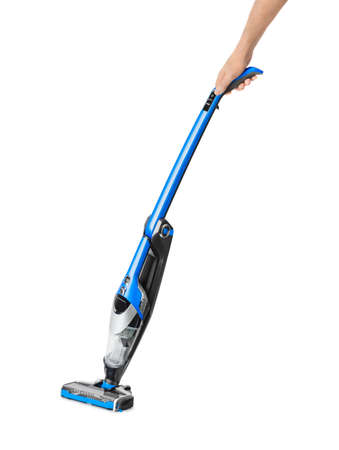 Cordless vacuum cleaner in hand isolated on white background Archivio Fotografico