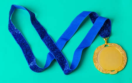 Gold medal on green background