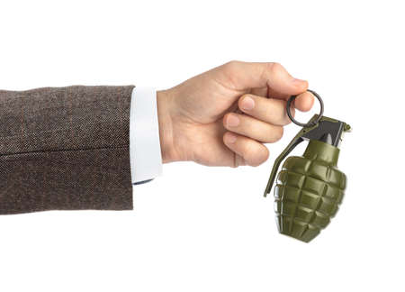 Hand with grenade isolated on white background
