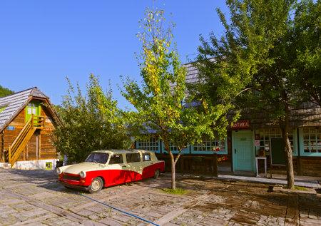 DRVENGRAD, SERBIA - SEPTEMBER 03: Retro cars in traditional village Drvengrad Mecavnik on September 03, 2015 in Drvengrad, Serbia.