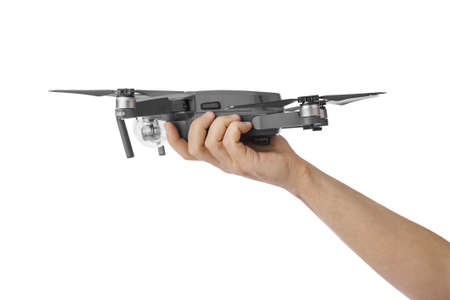DJI Mavic Pro drone: Moscow, Russia - September 24, 2017. Quadcopter drone in hand isolated on white background.