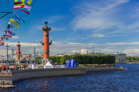 Saint-Petersburg, Russia - July 24, 2020: Rostral columns and the Neva River.