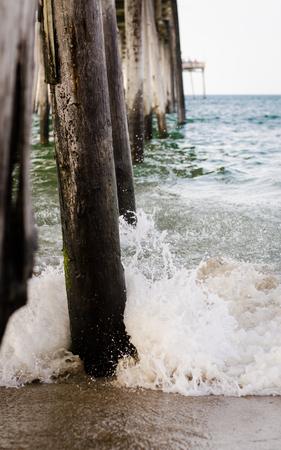 waves crashing: waves crashing on the pier