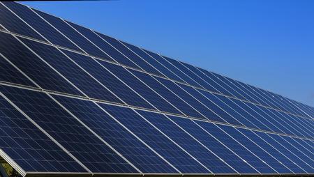 Closeup solar panels and blue sky background photo