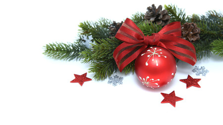 Decoration of green branches and christmas ball with ribbon isolated on white background photo