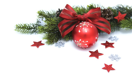 Christmas red ball with pine branches and ribbon isolated on white background photo