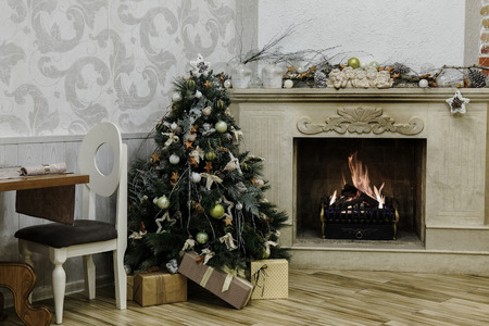 Christmas tree next to vintage fireplace photo