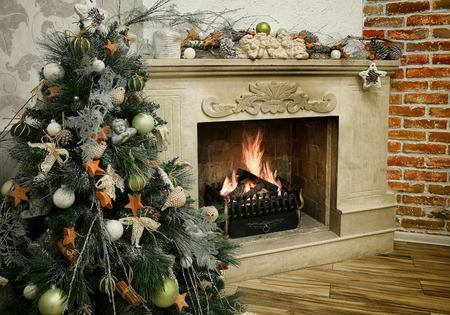Christmas tree next to marble fireplace Banco de Imagens