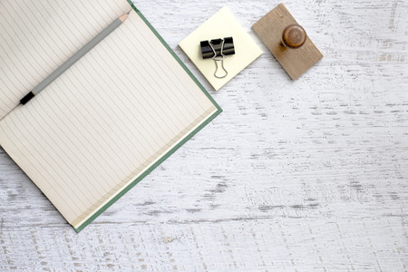 pinch: Office supplies, notebook, pencil, stamp, pinch, paper background Stock Photo