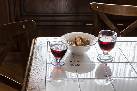 redish: Two glasses with redish juice and cookies in white bowl
