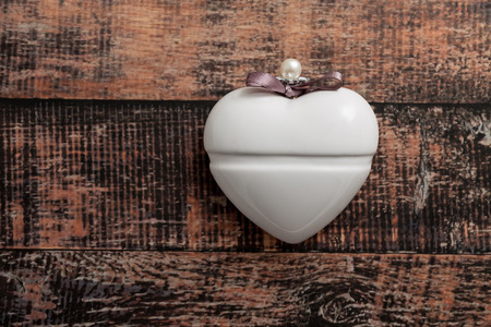 Vintage heart on wooden background, top view photo