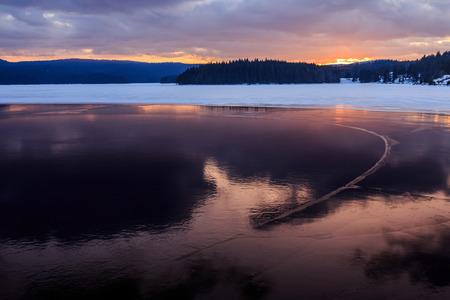 Mountainious lake in the winter photo