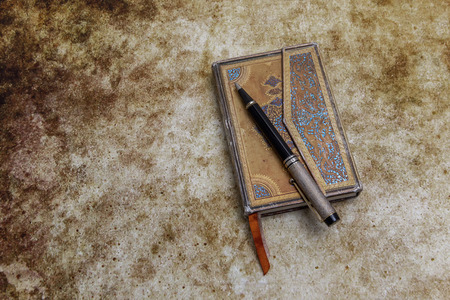 ornamented: Ornamented aged diary with pen