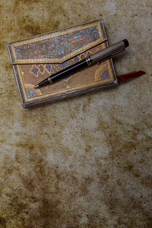 old diary: Beautiful ornamented old diary and pen