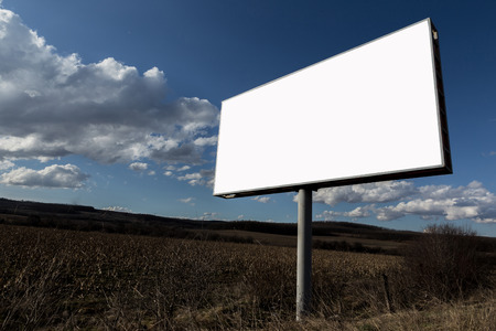the oblong: Big oblong white blank advertising billboard and clouds in sky