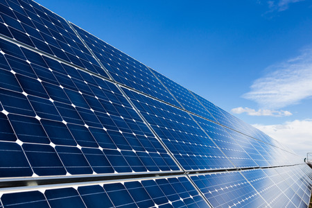 solar collector: Photovoltaic solar panels and sky with few clouds Stock Photo