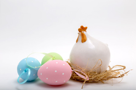 colorfully: Easter decoration of chicken china figure and colorfully painted eggs Stock Photo