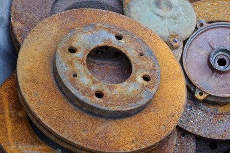 surface aged: Aged metallic brake discs with rusty surface Stock Photo