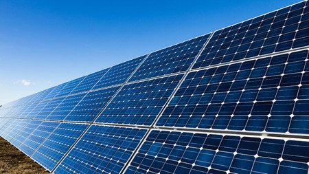 sun energy: One row of solar panels and the sky Stock Photo