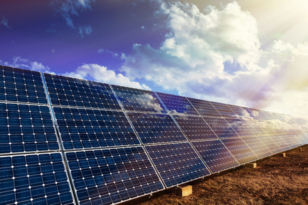 solar collector: Row of photovoltaic solar panels and sun reflection background Stock Photo