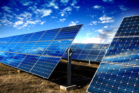 solar collector: Row of photovoltaic solar panels and sky background
