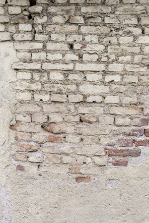 damaged cement: Brick wall with damaged cement surface Stock Photo