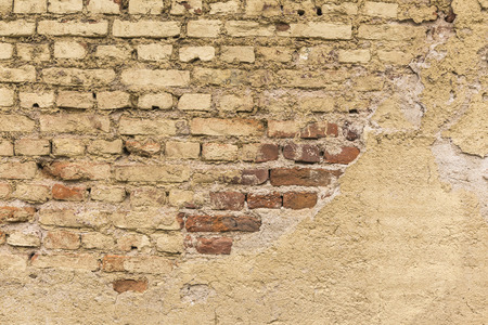 repent: Bricks repent of concrete plaster of wall Stock Photo