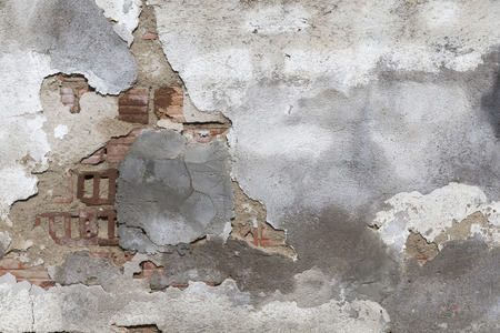 impaired: Impaired concrete plaster of damaged brick wall