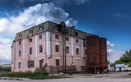 Old factory building crumbling with time, industrial scene Editorial