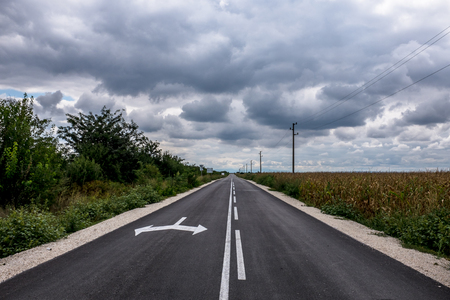 forthcoming: Infrastructure scenery of asphalt road in the nature