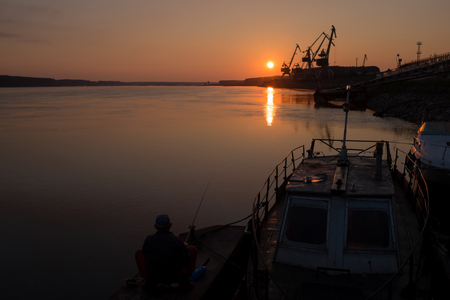 dawning: Fisherman standing by the river during dawning in the morning
