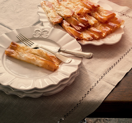 ornamented: Homemade pastry served in white ornamented plates