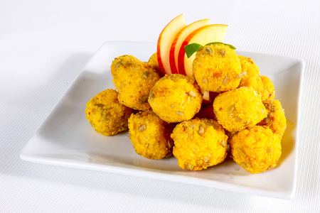 breaded: Closeup of breaded nuggets with decoration, food background