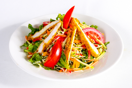 Mixed vegetables salad with grilled chicken, food background