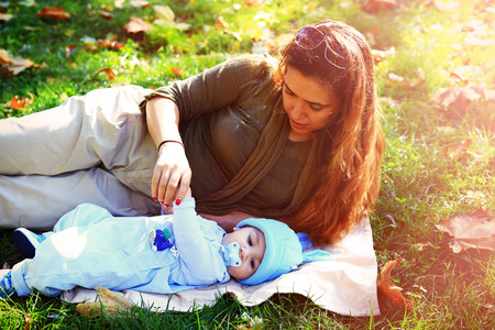 Mother with her loving baby lying on blanket, family values concept Stock Photo