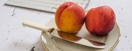 quick snack: Closeup of fresh peach fruit on the office table