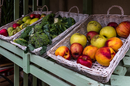 exposed: Fruits for sale exposed in wicker baskets of the market stand Stock Photo