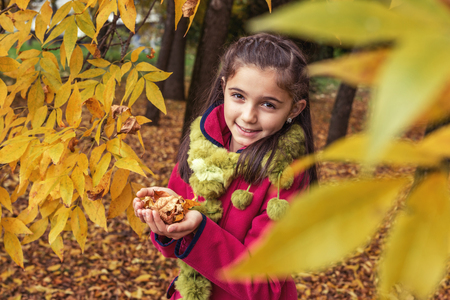 ouside: Seasonal portrait of young girl in autumn forest