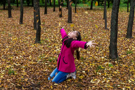 spreaded: Young teenage girl smiling with spreaded hands in the nature Stock Photo