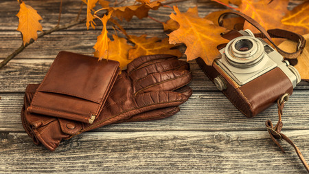 Closeup of luxurious leather items for winter season outfit on vintage wooden background Banco de Imagens