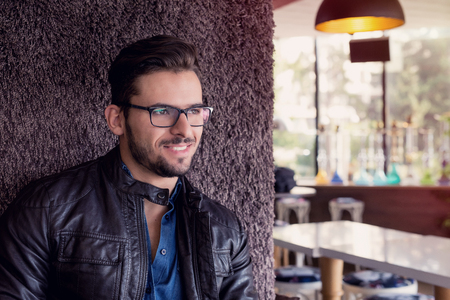 inteligent: Handsome young man with eyeglasses and smile on his face