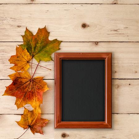 framed: Top view of blackboard framed in wooden frame on vintage background