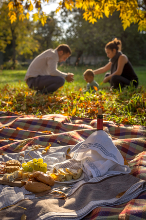 picknick: Young family having picknick in the autumn nature